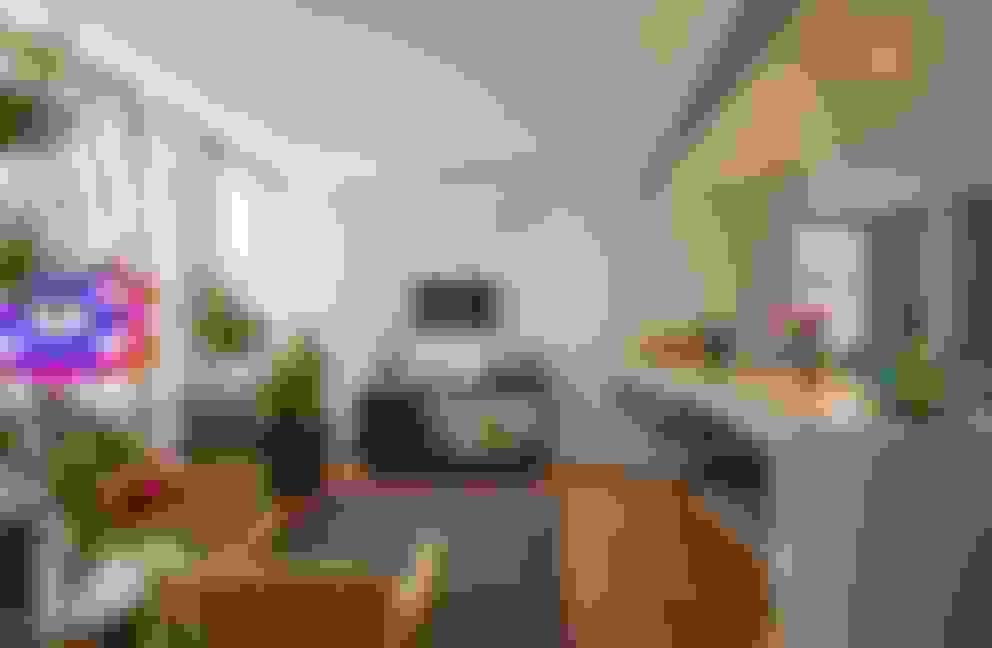 copa e cozinha, com pequena sala de tv: Salas de estar  por acr arquitetura