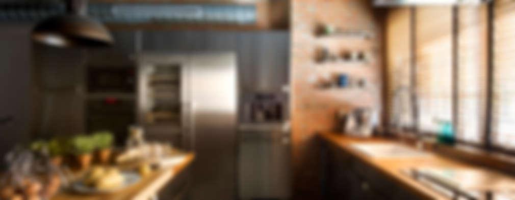 Cocinas de estilo rústico por Egue y Seta