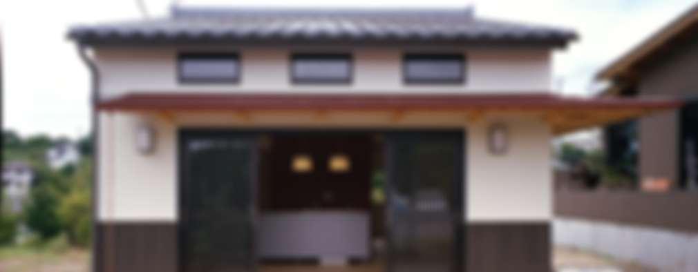 Casas de estilo ecléctico por 株式会社 遊墨設計