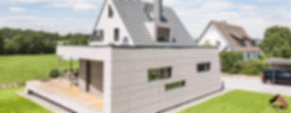 Casas de estilo moderno por wukowojac architekten