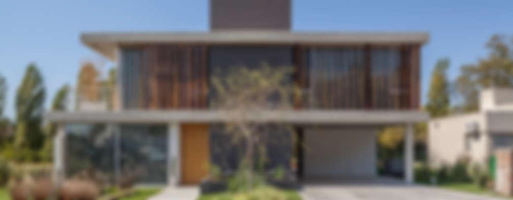 Casas de estilo moderno por ESTUDIO GEYA