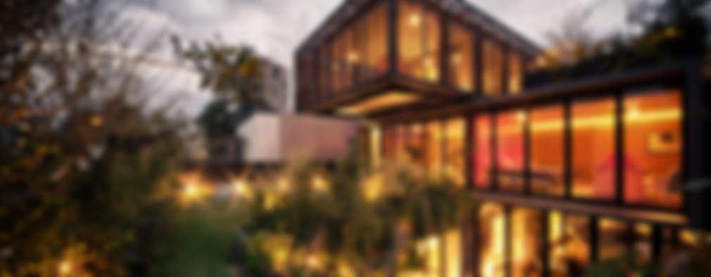 Casa PN: Casas de estilo moderno por ZD+A