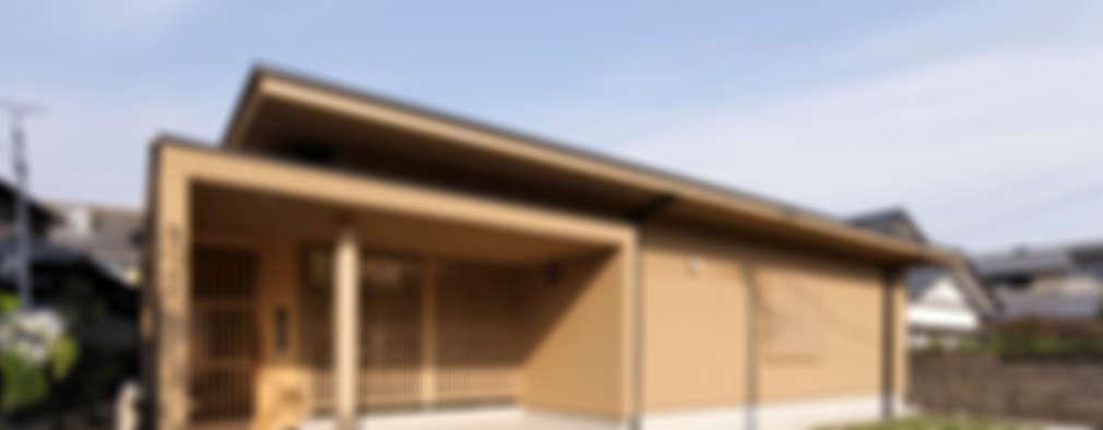 Casas de estilo ecléctico por 長谷雄聖建築設計事務所