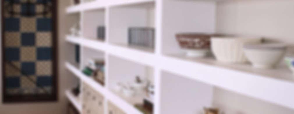 Livings de estilo ecléctico por Graf Arquitetura & Interiores