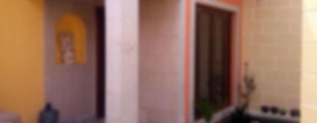 Pórtico de Acceso: Casas de estilo colonial por Estudio Ideas