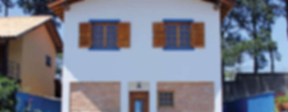 Projekty, rustykalne Domy zaprojektowane przez RAC ARQUITETURA