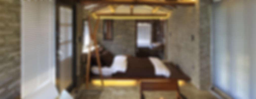 Dormitorios de estilo rústico por Z_Lab