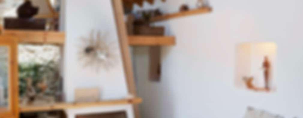 Salas de estar rústicas por pedro quintela studio