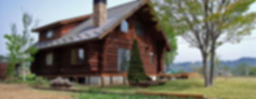 Projekty, wiejskie Domy zaprojektowane przez Cottage Style / コテージスタイル