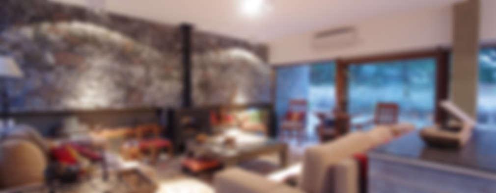 Salas de estilo moderno por LUCAS MC LEAN ARQUITECTO