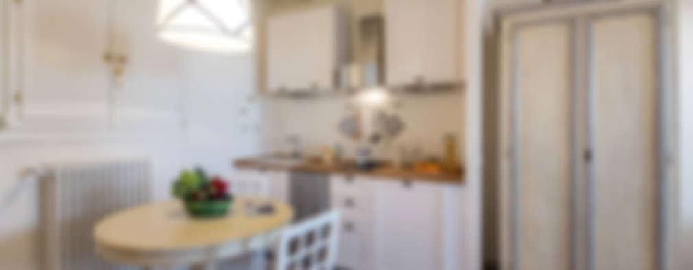 Cocinas de estilo rústico por STUDIO ARCHIFIRENZE