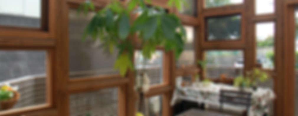 Jardines de invierno de estilo ecléctico por 株式会社グランデザイン一級建築士事務所
