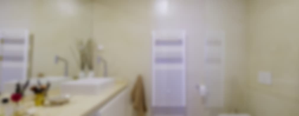 Baños de estilo moderno por MapOut