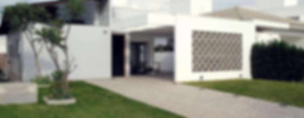 Casas de estilo moderno por Cia de Arquitetura