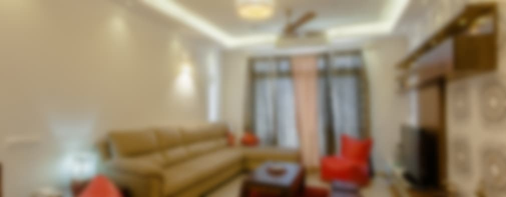 3 BHK partement : classic Living room by In Built Concepts