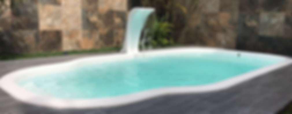 Alberca de fibra de vidrio: Albercas de jardín de estilo  por Kaland Water