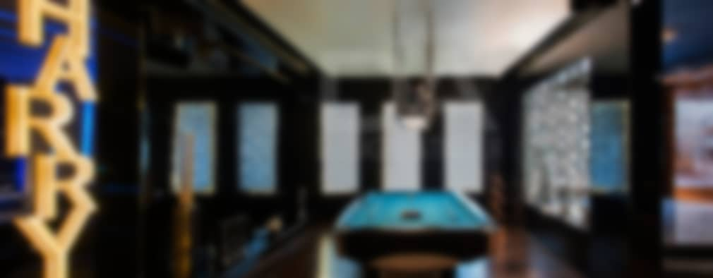 Pool Table Area with client's name cutout in back lit MDF: modern Pool by Design Atelier