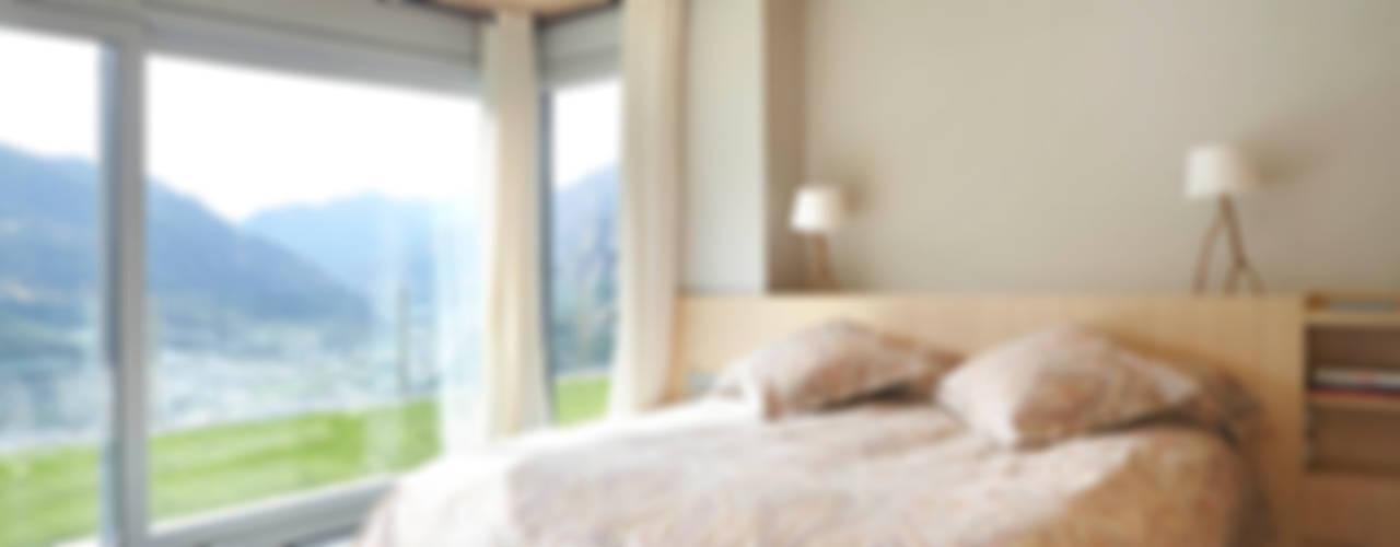 El continente y el contenido Dormitorios de estilo escandinavo de Coblonal Arquitectura Escandinavo