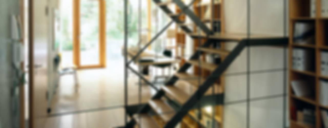 Deutschlands erstes Wohn- und Geschäftshaus im Passivhaus-Standard Industriale Bürogebäude von A-Z Architekten Industrial