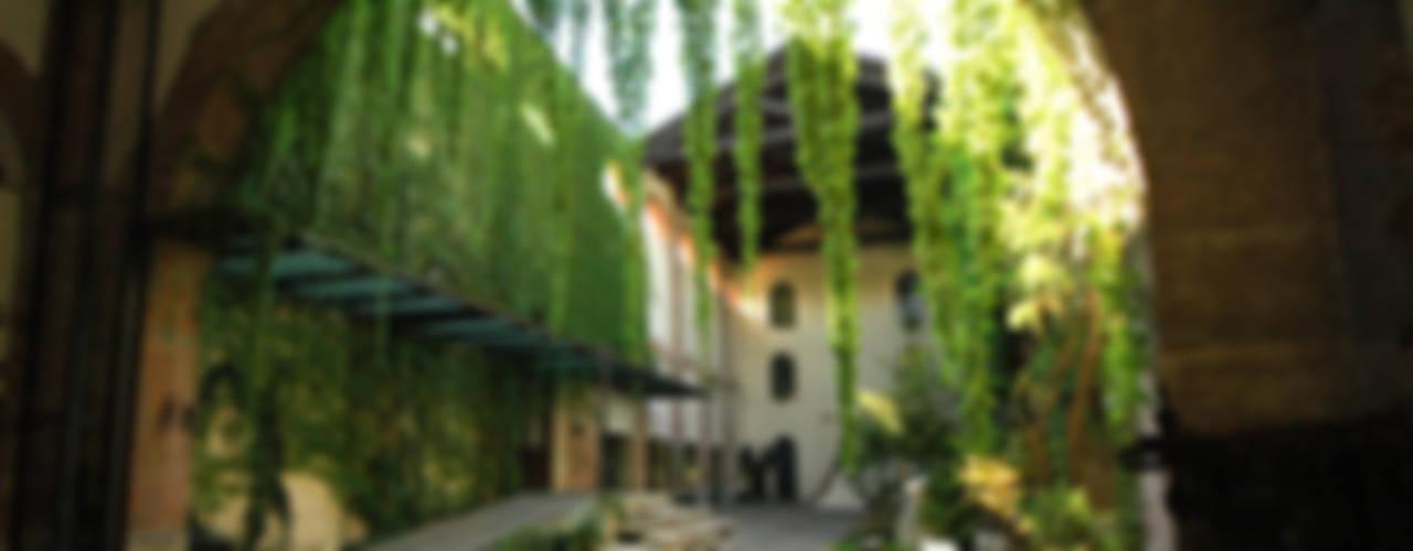 Ingresso alla Cappella del SER.MI.G Giardino rurale di Comoglio Architetti Rurale