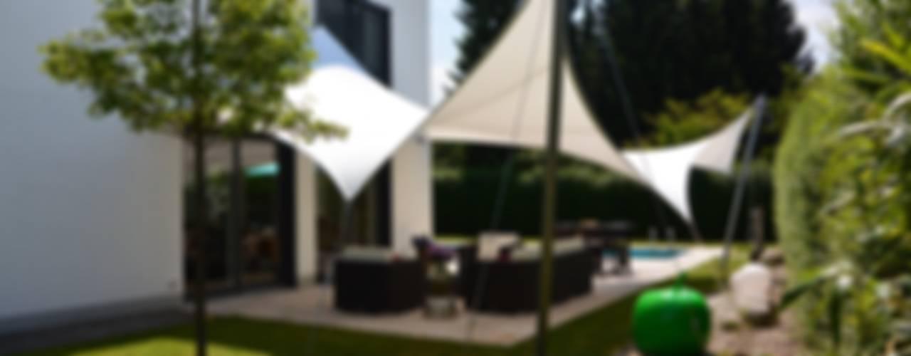 Sonnensegel und textile Architektur. Erleben Sie ein völlig neues Raumgefühl mit unseren Sonnensegelkonzepten (wasserdicht, individuell, sturmsicher und schneefest). von aeronautec GmbH Modern