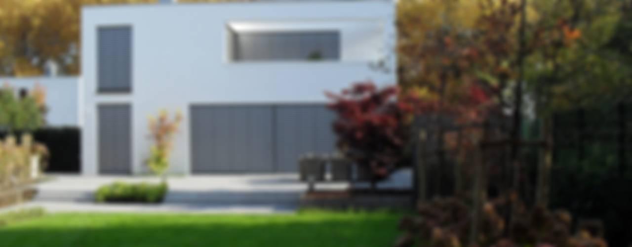 Einheit im Ganzen, Vielfalt in Teilen Minimalistische Häuser von Architekturbüro Sauer-Scholta Minimalistisch