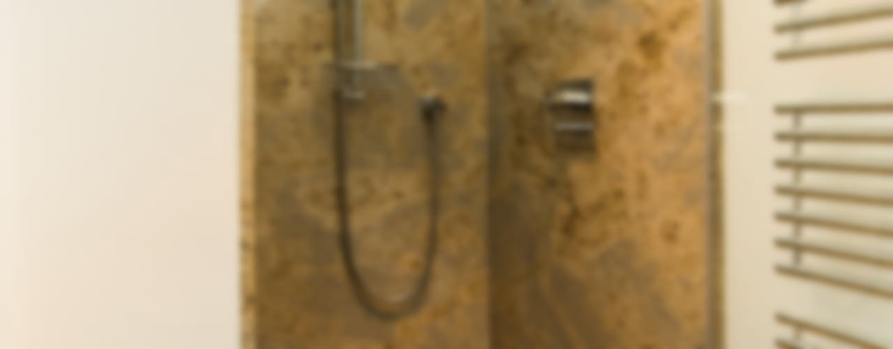 Geometrische Strukturen geben Badezimmern eine klare Linie von Pientka - Faszination Naturstein Modern