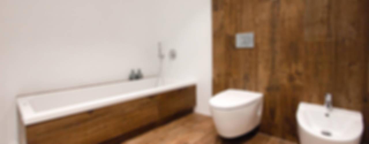 Casa Gerard, una vivienda ecoeficiente Baños de estilo minimalista de Chiralt Arquitectos Minimalista
