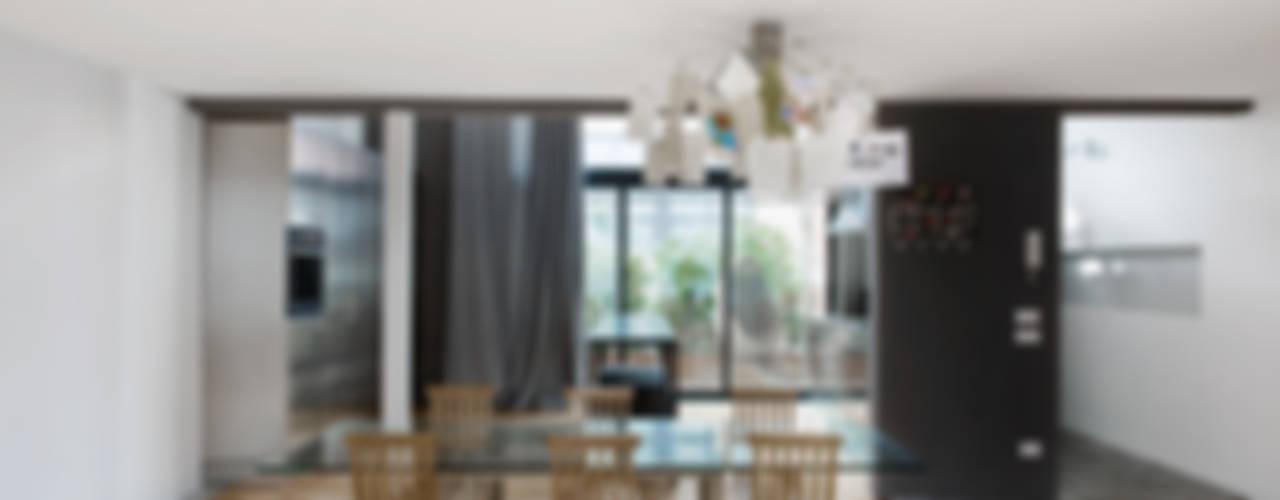 loft n° 5 Sala da pranzo in stile industriale di roberto murgia architetto Industrial