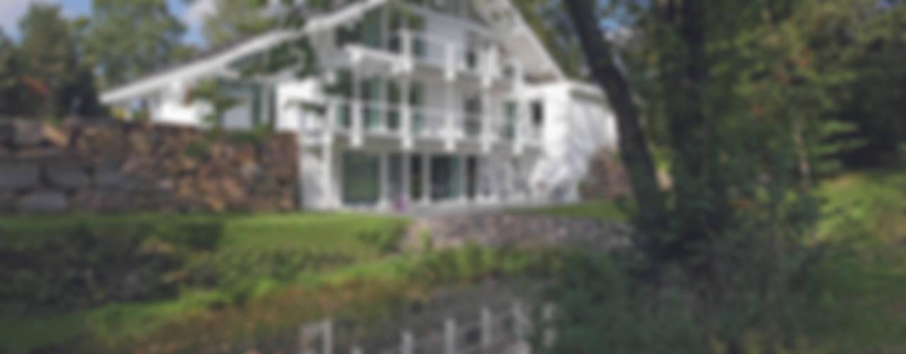 Casas estilo moderno: ideas, arquitectura e imágenes de DAVINCI HAUS GmbH & Co. KG Moderno