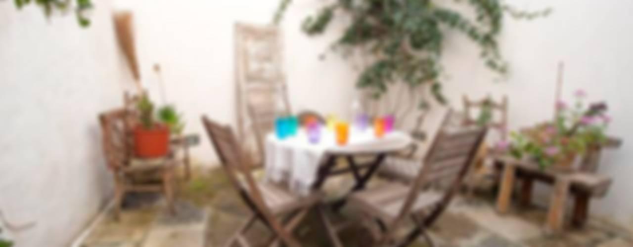 Dimora liberty decò Balcone, Veranda & Terrazza in stile eclettico di meb progetto ambiente Eclettico