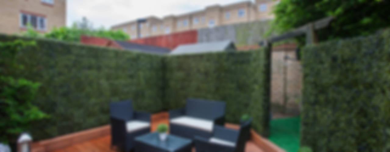 Garden - Canary Wharf Jardines de estilo moderno de Millennium Interior Designers Moderno