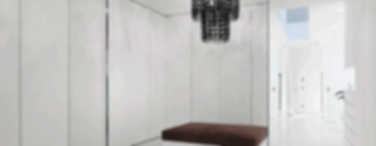 Closets de estilo  por monovolume architecture + design