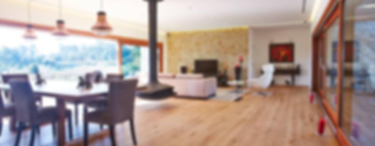 غرفة المعيشة تنفيذ HUGA ARQUITECTOS