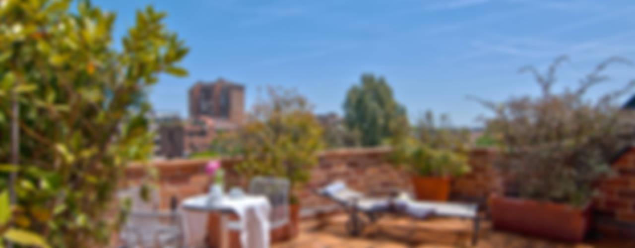 Home Staging de Altura en Arturo Soria Balcones y terrazas de estilo clásico de Apersonal Clásico