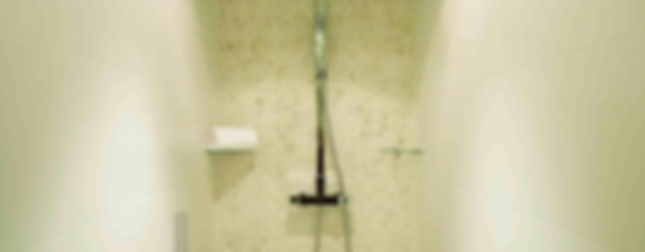 Apartamento Jazz Baños de estilo ecléctico de Ametrica & Interior, S.L. Ecléctico