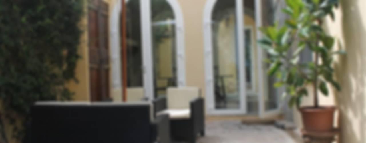 Abitazione in San Frediano, Firenze Studio Tecnico Progettisti Associati Ing. Marani Marco & Arch. Dei Claudia Balcone, Veranda & Terrazza in stile eclettico