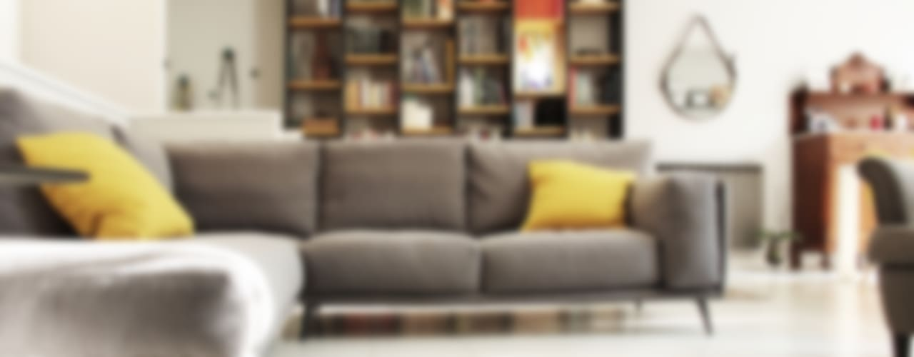Il divano: Soggiorno in stile in stile Moderno di Spazio 14 10 di Stella Passerini