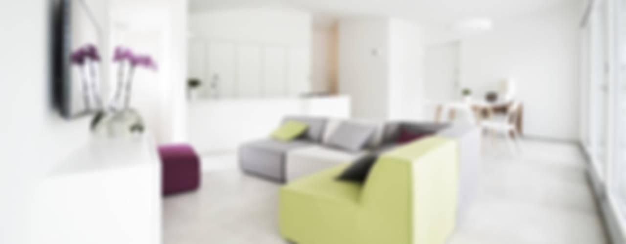 casa studio: abitare l'officina francesco valentini architetto Soggiorno moderno