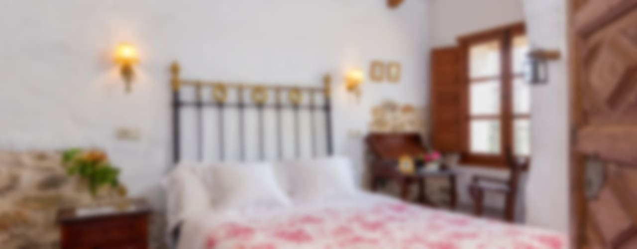 Dormitorios rústicos de Espacios y Luz Fotografía Rústico