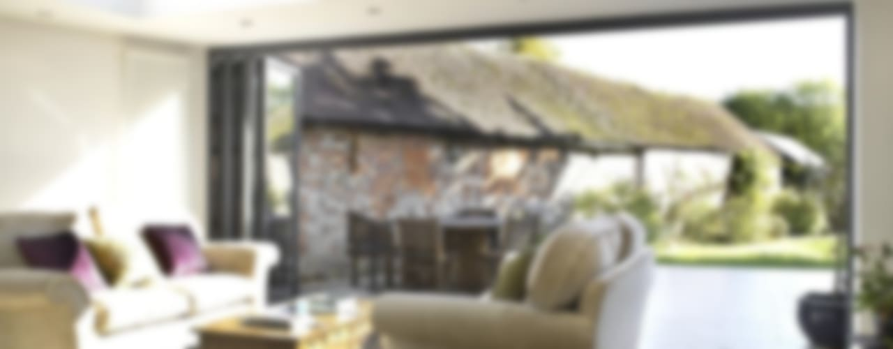 Bi-folding doors Modern conservatory by Viva Doors Ltd Modern