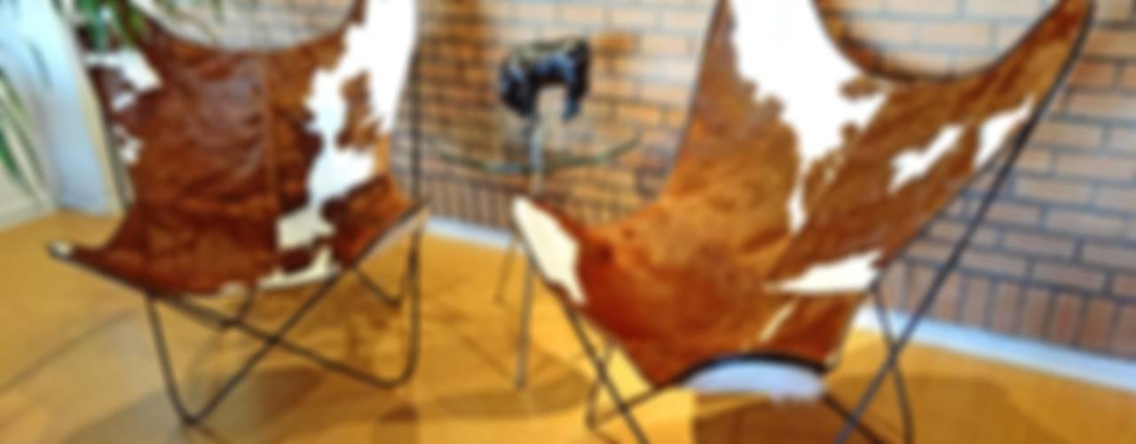 SILLON BKF EN CUERO VACUNO:  de estilo  por TAYLOR DECORACIONES