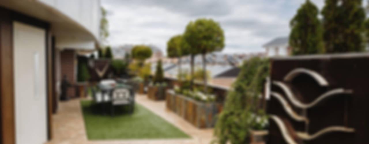 Un espacio renovado: Terrazas de estilo  de Slabon Forja Creativa