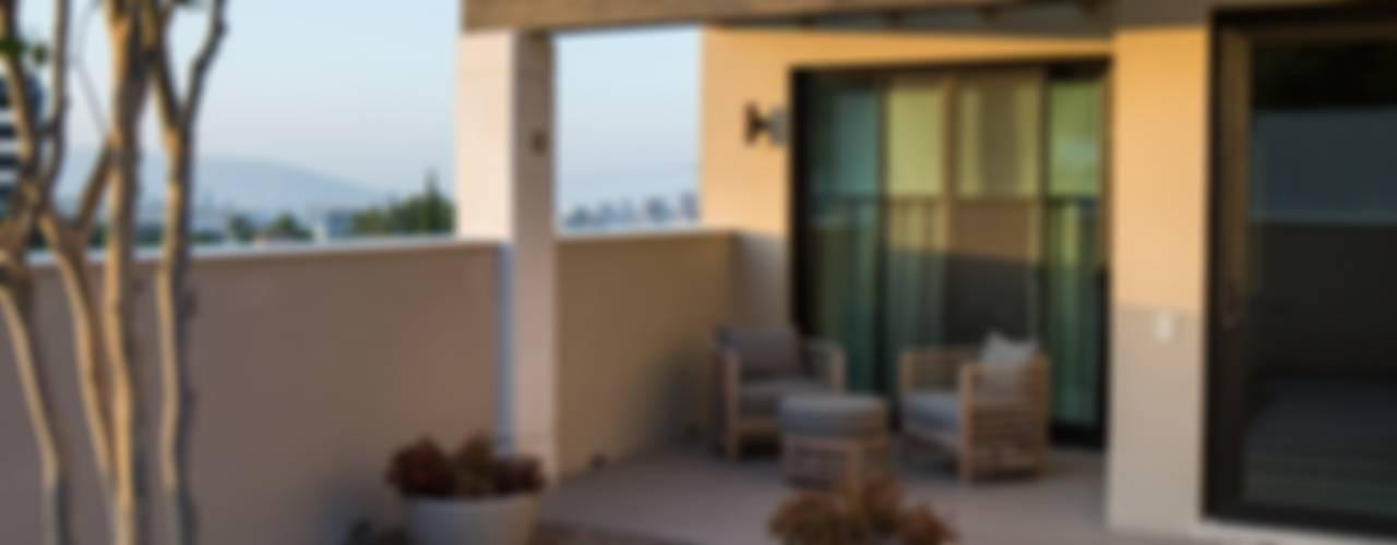 Balcones y terrazas modernos de Rousseau Arquitectos Moderno