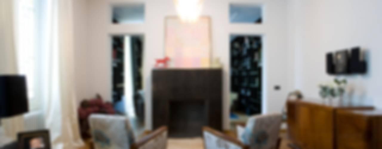 una casa deco' archbcstudio Soggiorno moderno