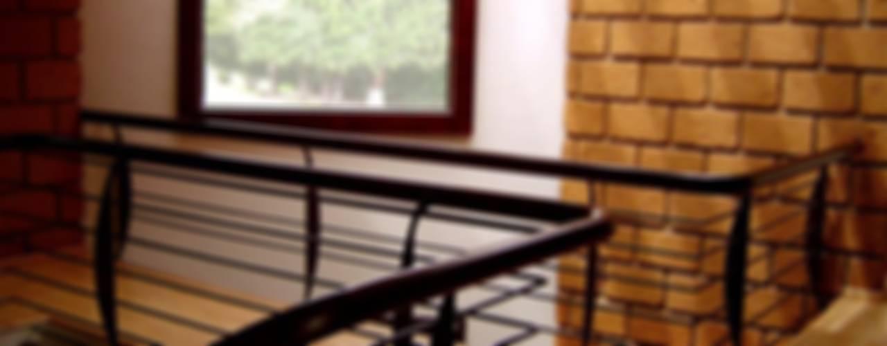 CASA ARBOLEDAS Pasillos, vestíbulos y escaleras rústicos de CESAR MONCADA SALAZAR (L2M ARQUITECTOS S DE RL DE CV) Rústico