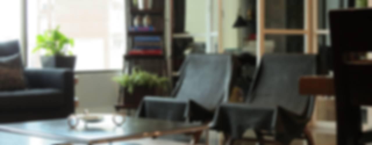 T801 14: Salas de estilo  por NIVEL TRES ARQUITECTURA