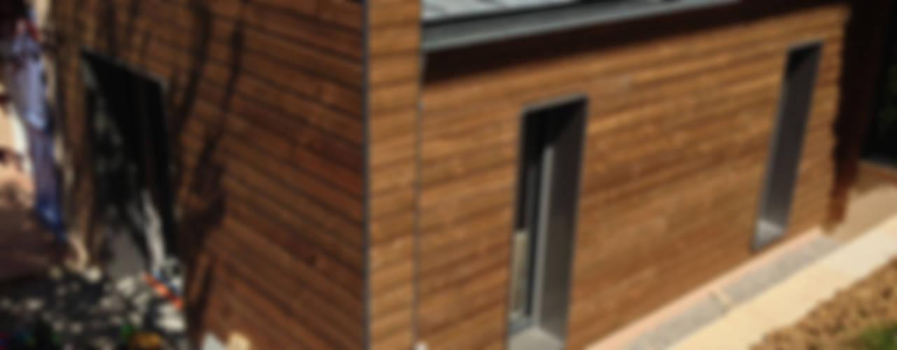 Extension d'une maison par IND Architecture Moderne