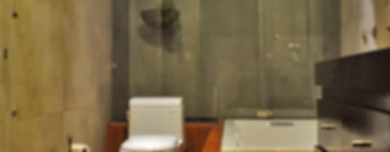 Baños de estilo  por CORTéS Arquitectos