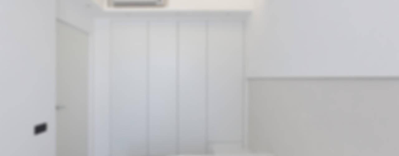 Dormitorios de estilo moderno de Arch. Andrea Pella Moderno